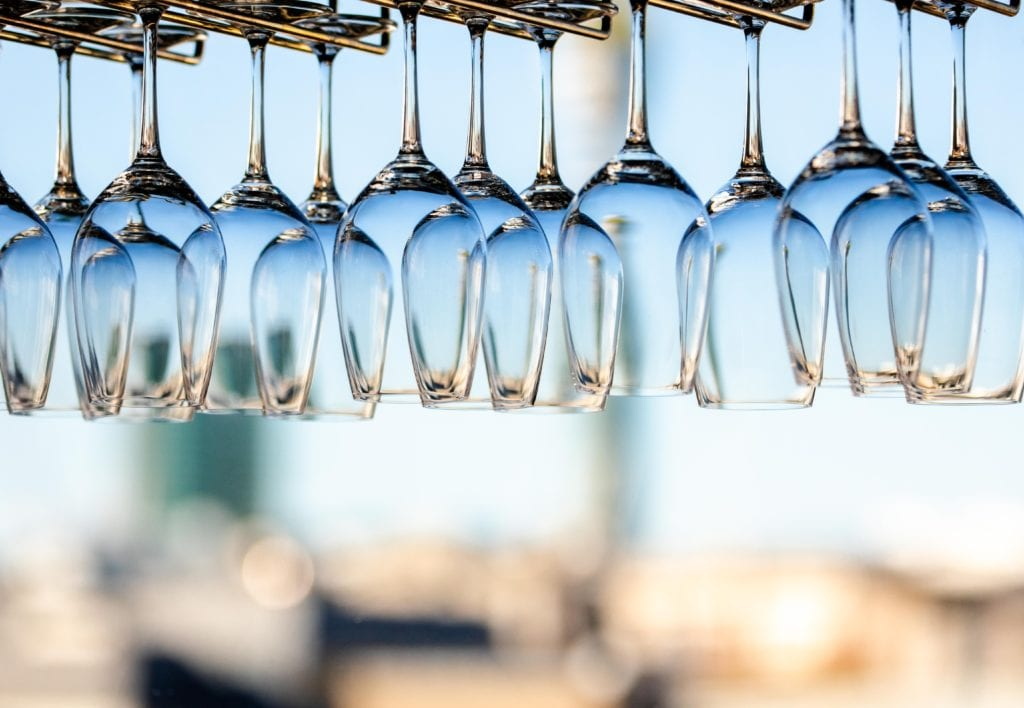 wine glasses hanging upside down, ready for your favorite wines