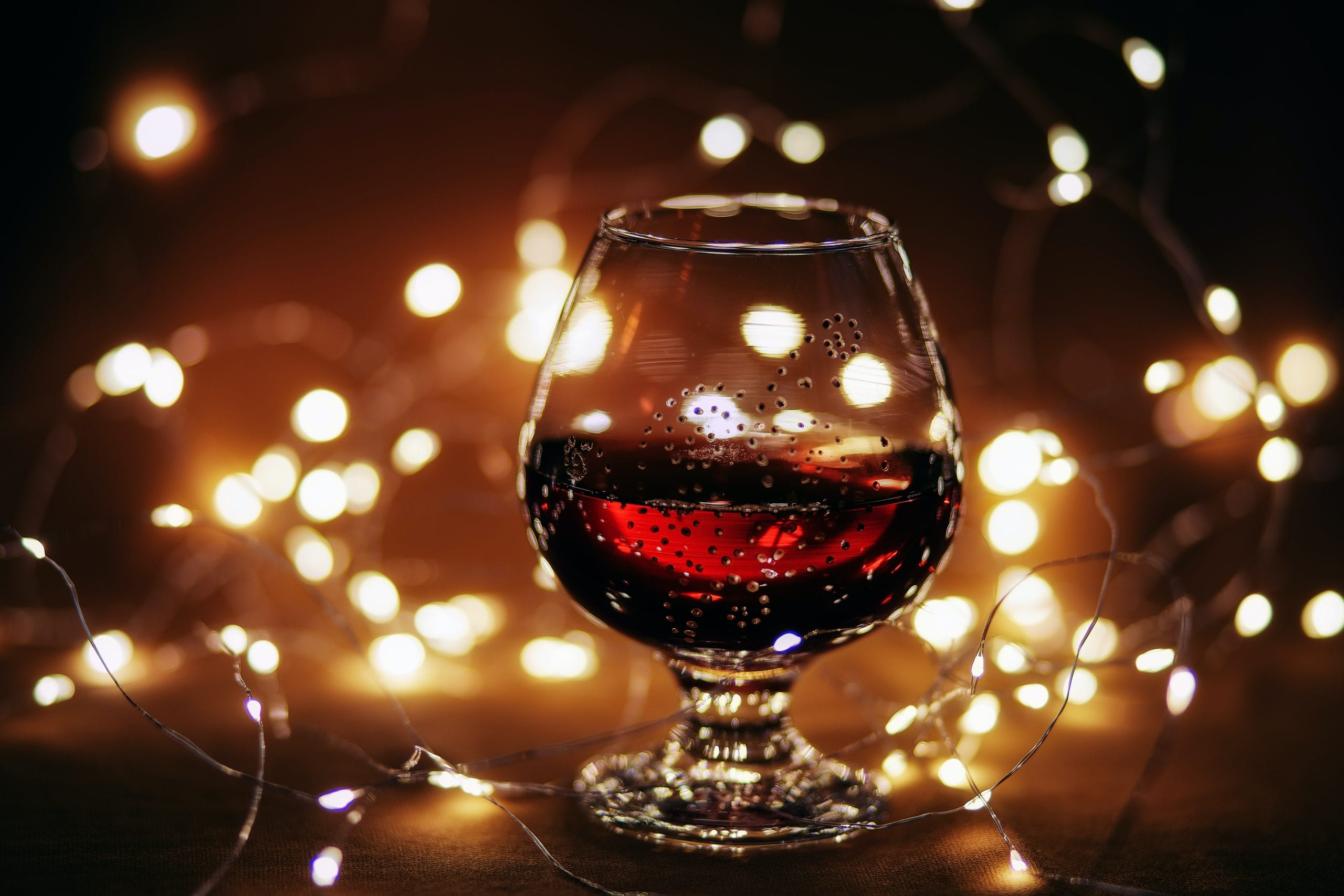 A port glass is a specialty wine glass and is specifically designed with a smaller size and narrow opening to reduce evaporation of this high-alcohol wine.