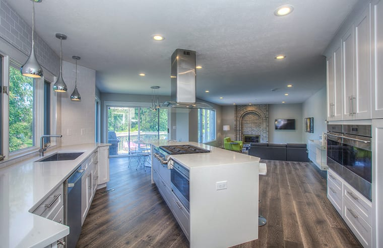 Adding essential appliances into the centre island will make cooking that much more social. Kitchen renovation and design
