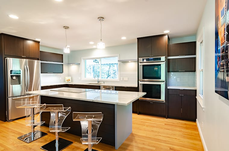 Let the cupboards go right to the ceiling to maximize storage options.