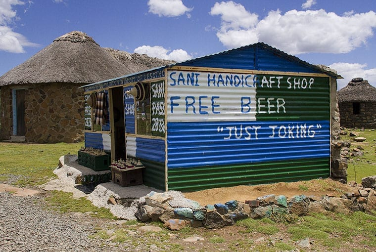 A joke about free beer at this craft shop brings smiles to tourists entering Lesotho via Sani Pass.