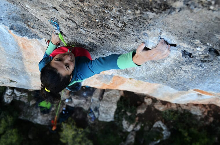 Climbing up a vertical crag requires focus and determination for rock climbers