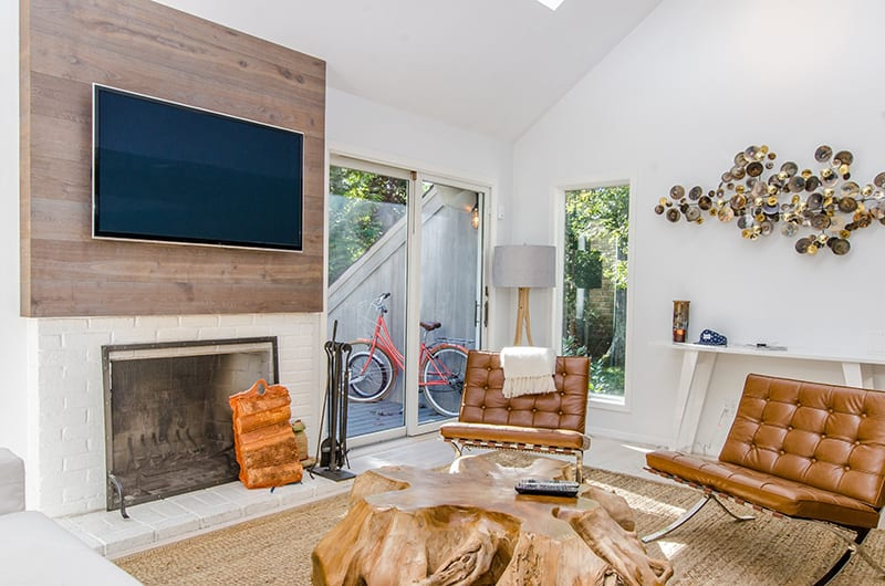 Hanging a TV above the fireplace is a clever way to use the space while enjoying the fire during your binge-watching